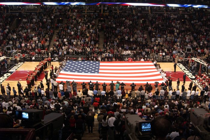 041105-N-1557B-001 Chicago, Ill. (Nov. 5, 2004) Ð Members from all the U.S. armed forces join the Chicago Bulls and New Jersey Nets in unfurling the American Flag at the Bulls home opener at the United Center in Chicago, Ill. The Bulls lost a thrilling double overtime decision to the Nets, 111-106. U.S. Navy photo by Dustan Burke (RELEASED)